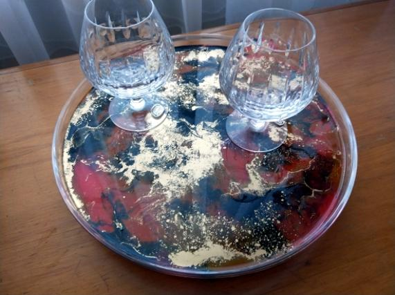 resin painting on lazy susan with brandy glasses